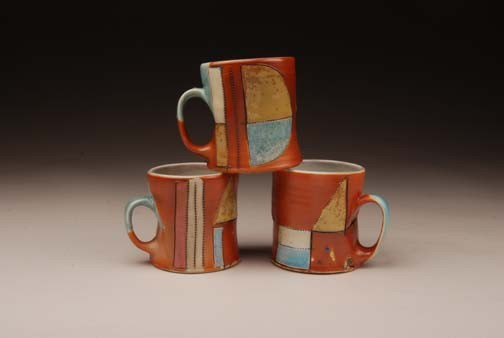 salt fired, decorated mugs