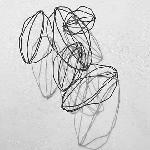 wire sculpture annealed steel negative space and shadows