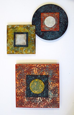 Fine art metallic paintings on acrylic squares and circles with patina finish wall sculpture