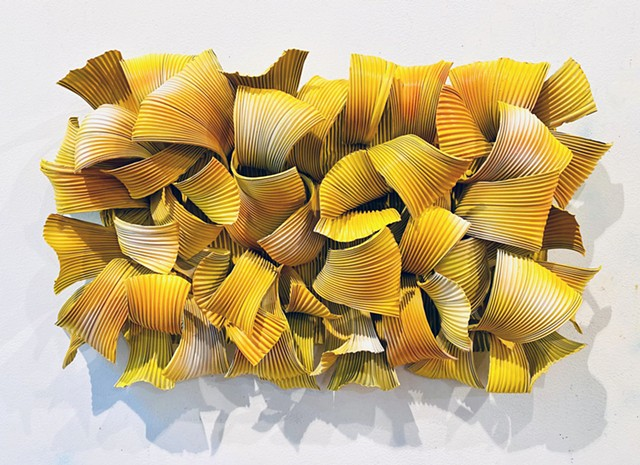 Yellow organic dimensional wall sculpture made of aluminum is contemporary