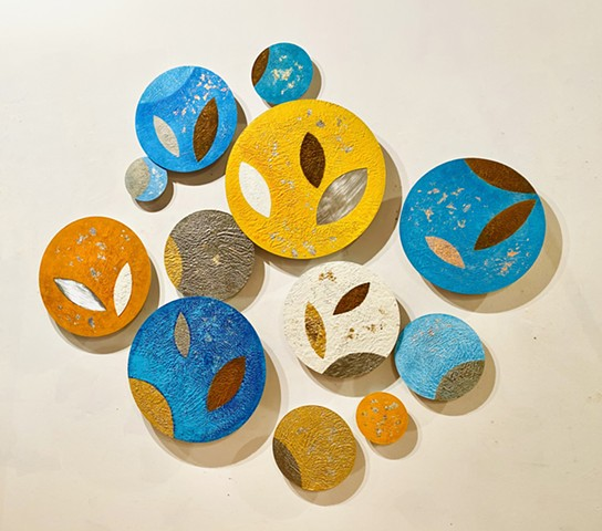 Seeds abstract wall art sculpture circles rust colorful orange blue yellow
