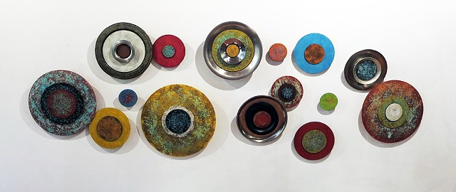 Found objects platters circles metallic paints acrylic elevated sculpture wall art