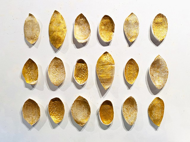 Gold seed shapes organic sculpure grouping modern minimalist