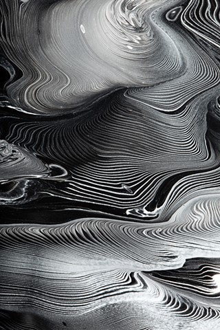 An abstract painting of the forces of nature. Black and white.