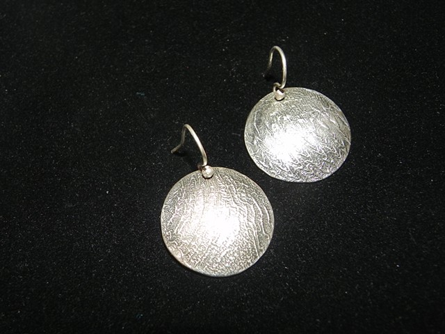Reticulated and fold formed silver and brass bimetal earrings; patinated