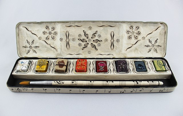 paint box, found object books, miniature books within a paintbox