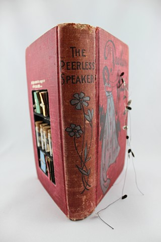 found book sculpture, found object art, transistor radio, oracle
