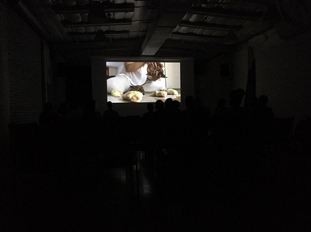 Documentation of screening ('My Own Sorrow(s)' by Melissa Tran featured on screen)