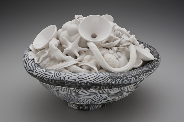 black and white bowl with white contents