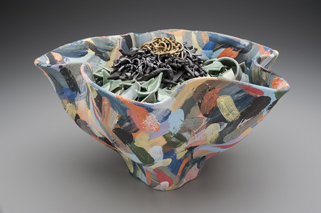 multicolored container with contents fused with glaze