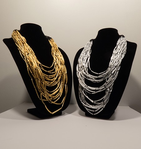 dentalium shell necklaces covered in gold leaf and silver leaf. Hupa