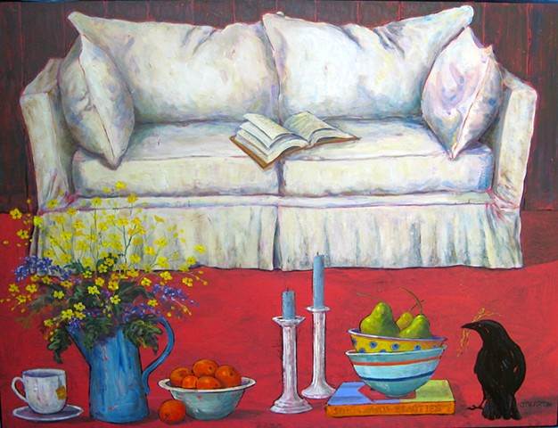 White sofa with still life, barn wall as backdrop.