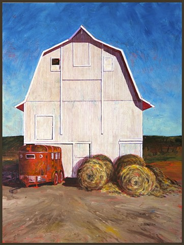 Large white barn, rusty red horse trailer, rolls of hay, bright blue sky