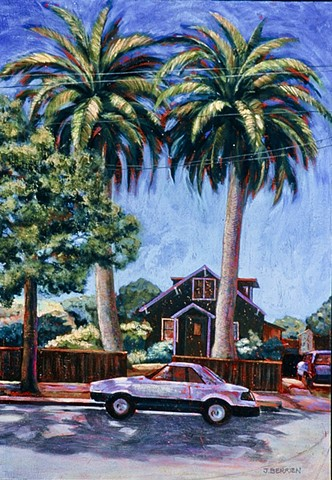 A Berkeley street scene.  A small wooden house framed by two towering palms.