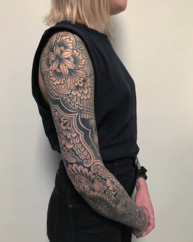 Ornamental floral pattern and blackwork sleeve by Alvaro Flores Tattooer from La Flor Sagrada Tattoo Melbourne Australia