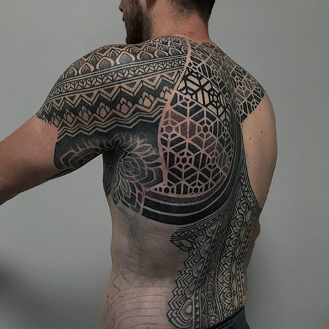 Back piece geometric mixed pattern in progress by Alvaro Flores Tattooer from La Flor Sagrada Tattoo Melbourne Australia