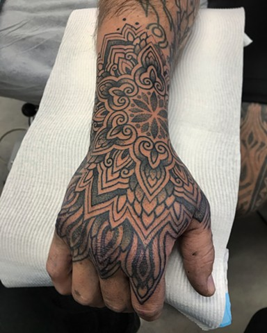 Ornamental thai style hand tattoo by Alvaro Flores Tattooer from La Flor Sagrada Tattoo in Melbourne Australia