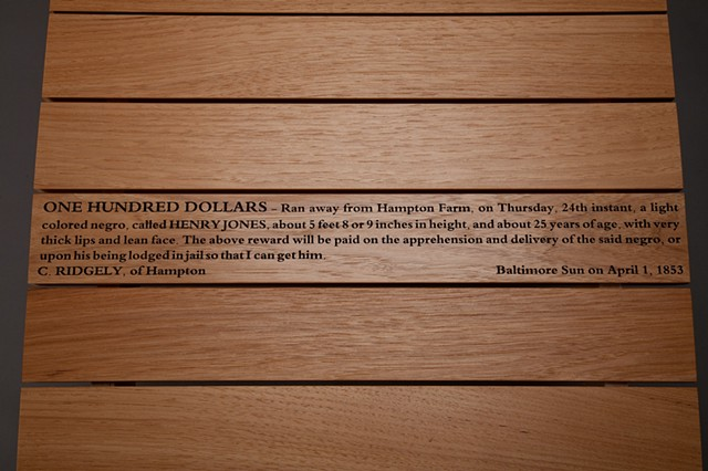 detail of laser cut text in Slave Bench