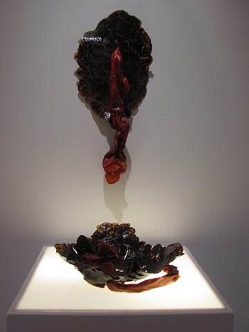 Sculpturally formed banana and fabric dyed turnip pressings.