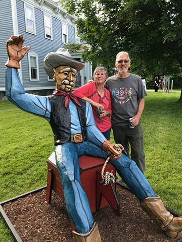 Buckaroo, cowboy, rodeo, bucking bronco, outdoor sculpture.