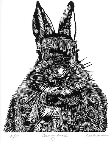 woodcut print of a bunny head