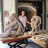 Loading Kiln for Cone 6 showing scale of work and artist Titsia Barnett, CSU Stanislaus