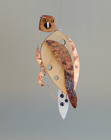 Hanging hawk sculpture