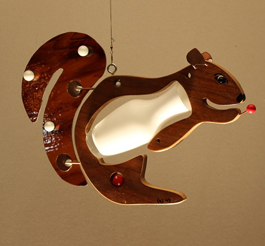 Hanging squirrel sculpture