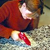 Sarah working on Millefiori at the kitchen table