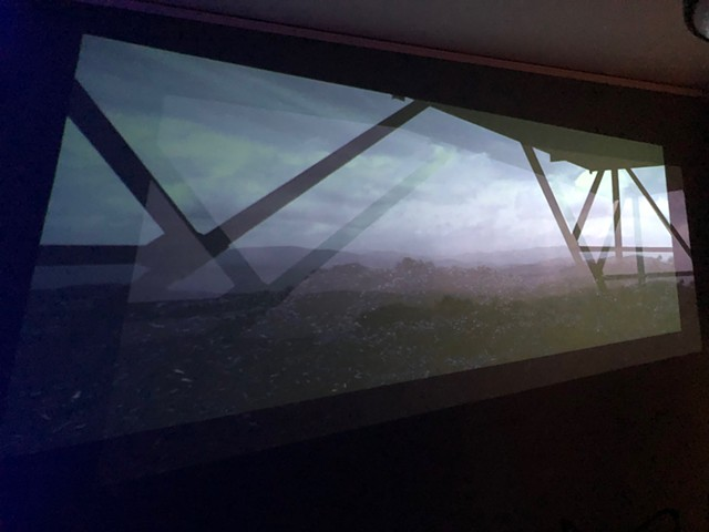 two channel video projection of mountainous landscape,art installation by Alice Pixley Young