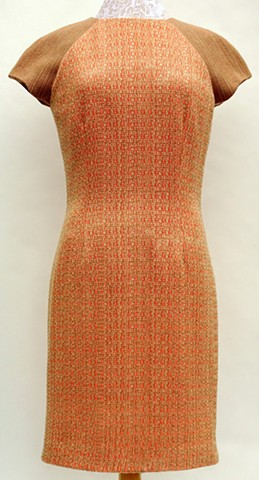 Handwoven dress in two variations of turned Beiderwand threading. Garment design and construction by Susan Stowell.