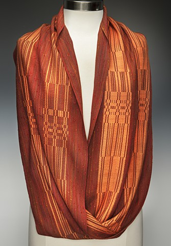 Mobius-shaped handwoven shawl with Muga silk