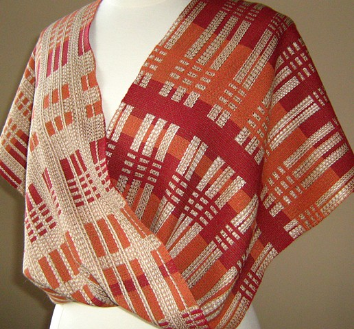 Handwoven mobius shawl in turned extended summer and winter. Variation on Missouri Check design by Atwater, in a style reminiscent of Wright architecture.