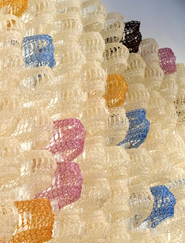 Geometric grid crocheted fiberglass and polyester resin wall sculpture based on the number e by Yvette Kaiser Smith