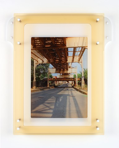 Digital pigment print on transparency film with laser-cut acrylic of urban setting by Yvette Kaiser Smith