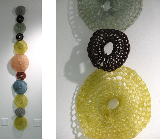 Minimal geometric crocheted fiberglass and polyester resin wall sculpture based on the number pi by Yvette Kaiser Smith