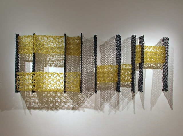 Minimal geometric crocheted fiberglass and polyester resin wall sculpture based on Pi by Yvette Kaiser Smith