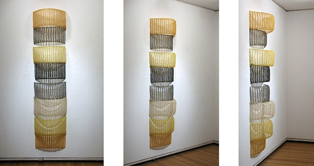 Crocheted fiberglass and polyester resin grid wall sculpture based on the number e  by Yvette Kaiser Smith