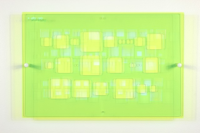 Green and blue laser-cut acrylic template with geometric pattern based on pi by Yvette Kaiser Smith