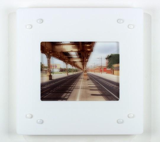 Digital pigment print on acrylic with laser-cut acrylic of urban setting by Yvette Kaiser Smith
