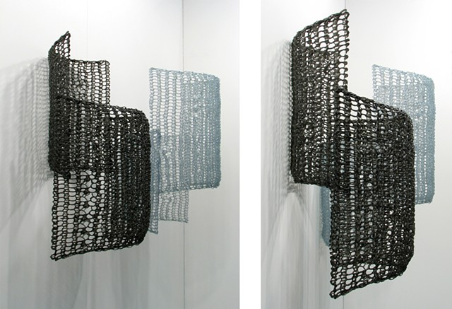 Geometric crocheted fiberglass and polyester resin wall sculpture based on Pi by Yvette Kaiser Smith