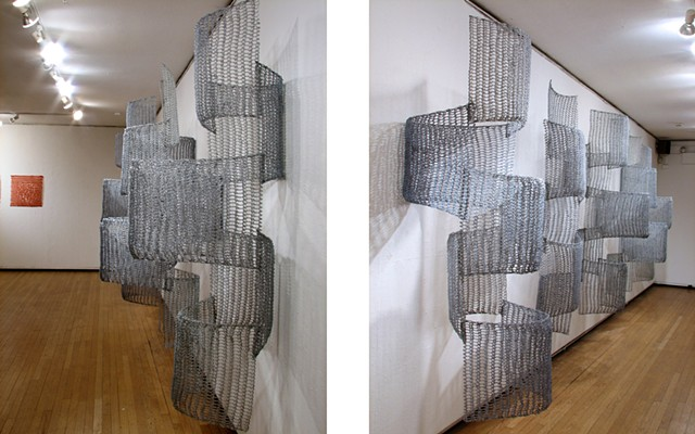 Organic geometric grid crocheted fiberglass and polyester resin wall sculpture based on Pi by Yvette Kaiser Smith