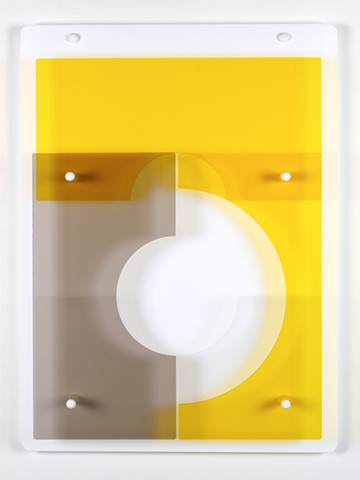 Geometric abstraction in laser-cut acrylic, white, brown, and yellow based on pi by Yvette Kaiser Smith