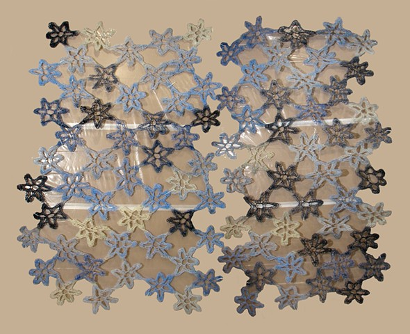 Crocheted fiberglass and polyester resin flower grid wall sculpture by Yvette Kaiser Smith