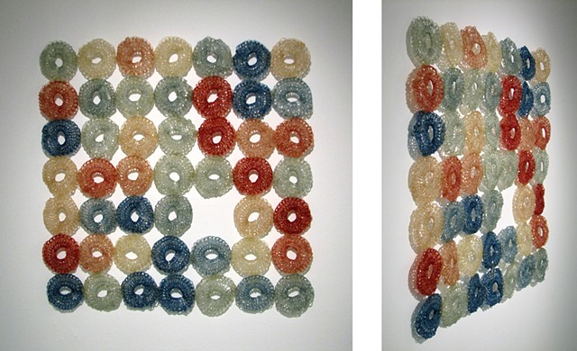 Minimal geometric crocheted fiberglass and polyester resin wall sculpture grid based on pi by Yvette Kaiser Smith