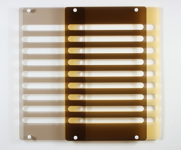 Geometric brown and yellow laser-cut acrylic sheet with spacers by Yvette Kaiser Smith