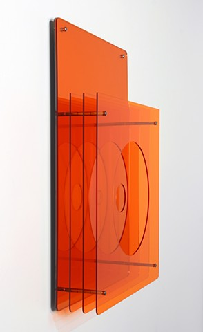 Geometric abstraction, based on number sequence, in mirrored and orange laser-cut acrylic based on e by Yvette Kaiser Smith