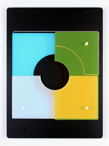 Black, white, yellow and blue laser cut acrylic geometric abstraction based on pi by Yvette Kaiser Smith