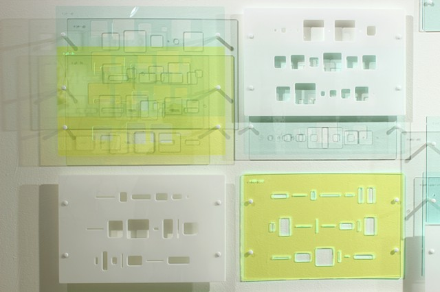 Green, blue, and white laser-cut acrylic template grid installation based on pi by Yvette Kaiser Smith