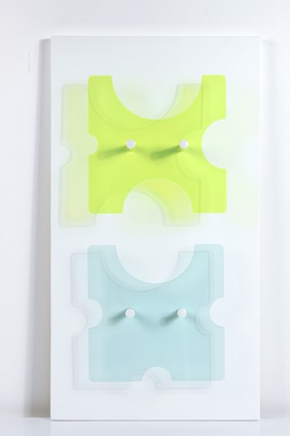 Geometric green and blue laser-cut acrylic sheet with spacers by Yvette Kaiser Smith